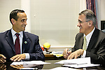 Mayor Joseph A. Curtatone and Tufts University President Anthony P. Monaco sign a partnership agreement between Tufts University and the City of Somerville in the mayor's office on Tuesday, October 22, 2013. (Alonso Nichols/Tufts University)