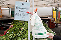 Biodegradable plastic bags at vegetable market stall. BioBag brand biodegradable and compostable plastic bags can be bought for 25 cents each. Ecology Center's Berkeley Farmers' Market prides itself on being a 'Zero Waste Zone' and prohibiting genetically modified foods. Berkeley, California, USA