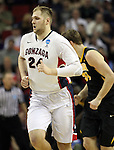 Gonzaga's Pryemek Karnowski (24) heads up court after dunking a basket against Iowa during the 2015 NCAA Division I Men's Basketball Championship's March 22, 2015 at the Key Arena in Seattle, Washington. #2 Gonzaga beat #7 Iowa 87-68 to advance to the Sweet 16.    ©2015. Jim Bryant Photo. ALL RIGHTS RESERVED.