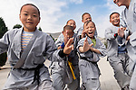 Young Shaolin Kung Fu students having fun at a traditional Shaolin school in DengFeng, Zhengzhou, Henan, China 2014