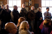 People listen to former Speaker of the House Newt Gingrich at a town hall meeting in Lancaster, New Hampshire.  Gingrich is seeking the 2012 Republican nomination for president.