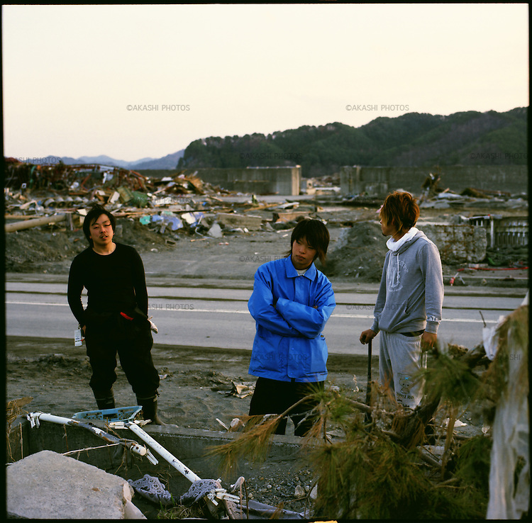 On May 11, 2011, the earthquake of magnitude 9.0, the biggest earthquake in the history of Japan and the fourth biggest earthquake in the world after year 1900, shocked the Tohoku area of Japan. In about 30 minutes, devastating tsunami reached, affecting the coastline with a length of 500 km (310 miles). The tsunami wave height of 39 meters (128 feet) was recorded in a port town in Tohoku. The tsunami swallowed villages along the coast and washed away all houses. The earthquake and tsunami killed more than 15,800 people, and still more than 3,500 people are missing. <br /> From left, Mitsuteru Kurasawa, 20, Kota Suzuki, 17, and Haruma Miura, 20, in their devastated town, Otsuchi, Iwate, in one month after the earthquake and tsunami. Mr. Kurasawa was fishing at port, Mr. Suzuki was in a driving school, and Mr. Miura was trying to let sleep his baby when the earthquake hit thier town. All of them evacuated right away, fearing for tsunami. &quot;We are so accustomed to tsunami warning that many of us did not believe,&quot; said Mr. Miura. The tsunami swallowed up the whole town of Otsuchi and left 802 people dead and 520 people missing. The mayor was also killed in the tsunami. &quot;Right now, we were roaming around the town to see something is left,&quot; Mr. Kurasawa said. &quot;But, there is nothing. We cannot even remember what was there. We have to start from Zero.&quot;