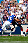 11 September 2005: David Carr, quarterback for the Houston Texans, is sacked by Aaron Schobel, in a game against the Buffalo Bills on September 11, 2005.  The Bills, wearing their 60s throwback uniforms, defeated the Texans 22-7, winning their first game of the season at Ralph Wilson Stadium in Orchard Park, NY.<br />