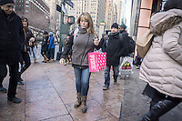 A woman with her Victoria's Secret purchase in Herald Square in New York on Saturday, January 30, 2016.  (© Richard B. Levine)