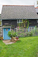This tiny cottage has been completely restored with clapboard walls and a slate roof