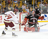 Brooks Dyroff (BC - 14), Chris Rawlings (Northeastern - 37) (Olesiak) - The Boston College Eagles defeated the Northeastern University Huskies 5-4 in their Hockey East Semi-Final on Friday, March 18, 2011, at TD Garden in Boston, Massachusetts.