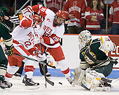 Ross Gaudet (BU - 22), Wade Megan (BU - 18), Rob Madore (Vermont - 29) - The visiting University of Vermont Catamounts tied the Boston University Terriers 3-3 in the opening game of their weekend series at Agganis Arena in Boston, Massachusetts, on Friday, February 25, 2011.
