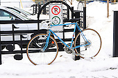 bicycle parked curve side in winter snow, Joliette Quebec