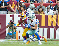 Dallas Cowboys wide receiver Cole Beasley (11) tries to elude Washington Redskins cornerback Josh Norman (24) in fourth quarter action during the game at FedEx Field in Landover, Maryland on Sunday, September 18, 2016.  Dallas Cowboys wide receiver Dez Bryant (88) look on from behind.  The Cowboys won the game 27 - 23.<br /> Credit: Ron Sachs / CNP /MediaPunch