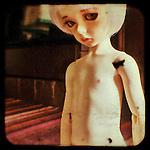 portrait of sad child doll