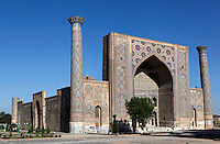 General view of Ulugh Begh Madrasah, 1417-20, Registan, Samarkand, Uzbekistan, pictured on July 19, 2010, in the morning. The lancet arched portal of this Madradsah, commissioned by the scholarly Ulugh Beg, faces the square and high well-proportioned minarets flank the corners. Geometrically patterned mosaic surrounds the entrance arch. It was restored in the early twentieth century. Samarkand, a city on the Silk Road, founded as Afrosiab in the 7th century BC, is a meeting point for the world's cultures. Its most important development was in the Timurid period, 14th to 15th centuries. Picture by Manuel Cohen.