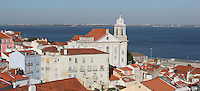 View over the rooftops of Alfama, the oldest district in the city and the original Moorish area, Lisbon, Portugal, with the Tagus river estuary behind. Picture by Manuel Cohen