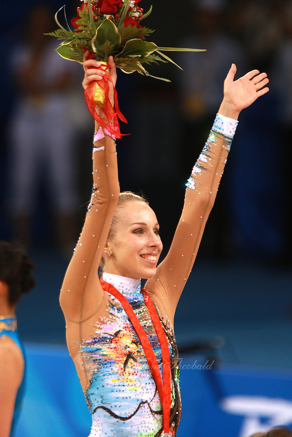August 23, 2008; Beijing, China; Rhythmic gymnast Inna Zhukova of Belarus celebrates winning silver in Individual All-Around during medal ceremony at 2008 Beijing Olympics..