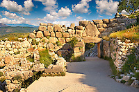 Mycenae Lion Gate & citadel walls built in 1350 B.C and known as cyclopean style walls due to the vast size of the blocks it was assumed by visitors in ancientb times that only giant Cycopse could have built them. Excavated by the archaeologist Heinrich Schliemann in 1876.  Mycenae UNESCO World Heritage  Archaeological Site, Peloponnese, Greece