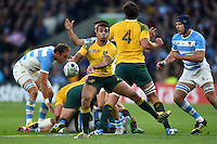 Will Genia of Australia passes the ball. Rugby World Cup Semi Final between Argentina v Australia on October 25, 2015 at Twickenham Stadium in London, England. Photo by: Patrick Khachfe / Onside Images