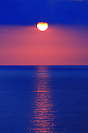 Sunset images of the World -non trivial with colorful red and yellow skies and oceans. 985 photos