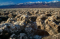 739650032 the devils golf course in the arid plains below the panamint mountains in death valley national park californai