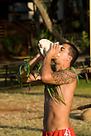 Hawaii: Molokai,  young man blowing conch shell, people at protocol spiritual ceremonies at Kaupoa Beach..Photo himolo204-71950..Photo copyright Lee Foster, www.fostertravel.com, lee@fostertravel.com, 510-549-2202