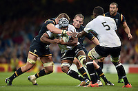 Dominiko Waqaniburotu of Fiji takes on the Wales defence. Rugby World Cup Pool A match between Wales and Fiji on October 1, 2015 at the Millennium Stadium in Cardiff, Wales. Photo by: Patrick Khachfe / Onside Images
