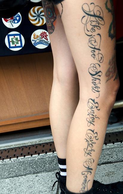 Japanese girl's tatto along length of her leg.