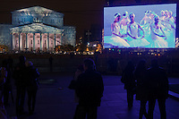 Moscow, Russia, 28/10/2011..A scene from Swan Lake is relayed to giant outdoor video screens on Ploschad Revolutsii, where crowds gathered to watch the reopening of the Bolshoi Theatre. It had had been closed since 2005 for reconstruction work that cost some $700 million.