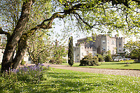 Tha castellated facade of Glin Castle viewed from the leafy garden