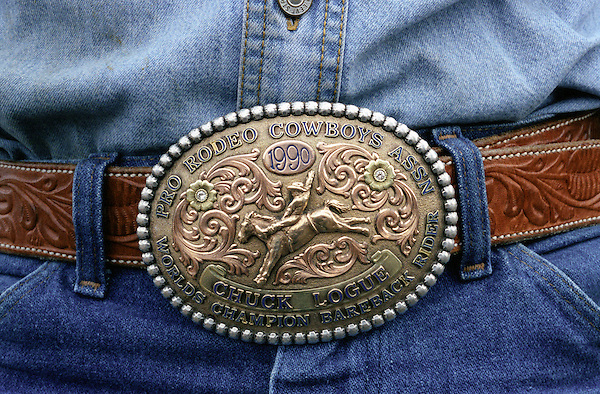 KISSIMMEE, FLORIDA : Chuck Logue wears his Champion Bareback Rider 1990 belt buckle at a PRCA (Professional Rodeo Cowboys Association ) Extreme Bulls rodeo event. The Xtreme Bulls Series was established in 2003 by the PRCA as a way to showcase rodeos most popular event bull riding. The Xtreme Bulls makes 10 stops in 8-cities, are televised and feature the best in bull riding from the bulls to the cowboys. Kissimmee, Florida. USA.