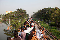 Bangladeshi people heading to their respective villages for the upcoming Muslim religious festival Eid-al-Adha. In order to catch a train, they overcrowd stations and train cars beyond imagination, climbing on roofs or hanging on any protrusion at their reach. Dhaka, Bangladesh, Oct. 03, 2014.