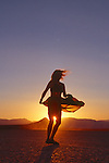 Woman dancing in the sunset, in the Black Rock Desert