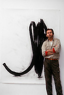 Canal St, New York City, New York - April 14th,1986. Photograph taken of Bernar Venet standing infront of a drawing at his New York studio. Bernar Venet (born 21 April 1941) is a French conceptual artist who has exhibited his works in various locations around the world.