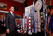 United States President Barack Obama talks with Team America Rocketry Challenge (TARC)  of Presidio, Texas, while touring student science fair projects on exhibt at the White House in Washington, D.C. on February 7, 2012.  Obama hosted the second White House Science Fair celebrating the student winners of science, technology, engineering and math (STEM) competitions from across the country. .Credit: Molly Riley / Pool via CNP