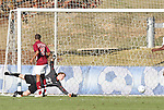 09 November 2010: Virginia Tech's James Daly (27) is beaten for a an NC State goal late in the game as teammate Devante Dubose (21) watches. The North Carolina State University Wolfpack defeated the Virginia Tech Hokies 6-3 at Koka Booth Stadium at WakeMed Soccer Park in Cary, North Carolina in the ACC Men's Soccer Tournament Play-In game.