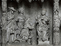 Jesus sits on his mother's knee while the 3 kings bless him and present their gifts, he raises a hand in blessing. The Adoration of the Magi, by Jean Soulas, upper scene from the choir screen, 1519-25, Chartres Cathedral, Eure-et-Loir, France. These sculpted scenes show the change in style from Gothic to Renaissance in the early 16th century in France. Chartres cathedral was built 1194-1250 and is a fine example of Gothic architecture. It was declared a UNESCO World Heritage Site in 1979. Picture by Manuel Cohen.