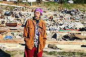 May 18, 2011; Minamisanriku, Miyagi Pref., Japan - Jun Suzuki stands where his house used to be and surveys the damage in Minamisanriku after the magnitude 9.0 Great East Japan Earthquake and Tsunami that devastated the Tohoku region of Japan on March 11, 2011...Everything from his house was washed away. He can't find anything.