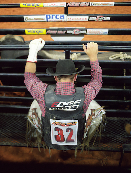 KISSIMMEE, FLORIDA: Bull rider Blue Stone says a prayer before riding a bull at an PRCA Pro Rodeo bullriding event in Kissimmee, Florida, USA.