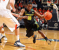 Dec. 17, 2010; Charlottesville, VA, USA; Oregon Ducks guard Johnathan Loyd (10) drives past Virginia Cavaliers guard Joe Harris (12) during the first half of the game at the John Paul Jones Arena. Mandatory Credit: Andrew Shurtleff