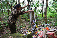 Rubbish being dumped in a forest above a lake, nr Makassar, Sulawesi, Indonesia.