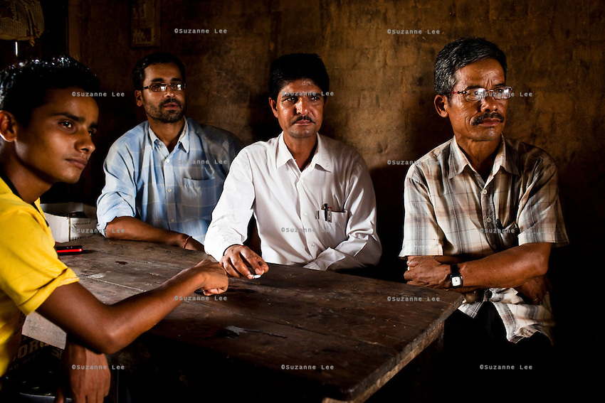 Village Child Protection Committee (VCPC) members (L-R) Dhundi Raj Tiwari (20), Mahanan Acharya (40), Durga Prasad Bhatarai (46), and Harsha Bahadur Pun (63) speak of their work and the issues of child marriage  in Lekhapharsa vilage, Surkhet district, Western Nepal, on 30th June 2012. The VCPC works to intervene in child marriages such as the case of Pramila and is supported by Save the Children and local NGO Safer Societies. In Surkhet, StC partners with Safer Society, a local NGO which advocates for child rights and against child marriage. Photo by Suzanne Lee for Save The Children UK