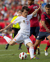 Spain forward David Silva (21) passes as USA defender   Eric Lichaj (14) defends. In a friendly match, Spain defeated USA, 4-0, at Gillette Stadium on June 4, 2011.