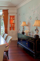 The upholstered wall adds beauty and  acoustic control to the room