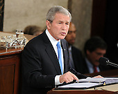 """Washington, D.C. - January 28, 2008 -- United States President George W. Bush delivers his final State of the Union Address to a Joint Session of the United States Congress in the Chamber of the United States House of Representatives in Washington, D.C. on Monday, January 28, 2008. In his speech, the President spoke about the economy, housing, trade, the Iraq War, Iran, and the need for bi-partisan cooperation to """"show that Republicans and Democrats can compete for votes and cooperate for results at the same time."""" .Credit: Ron Sachs / CNP"""