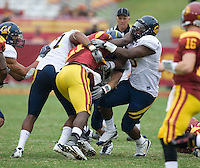CAL defenders' Keith Browner and D.J. Holt tackle Allen Bradford of USC during the game at LA Memorial Coliseum in Los Angeles, California.  USC defeated California, 48-14.