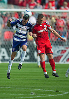 24 July 2010: FC Dallas midfielder Eric Alexander #24 and Toronto FC forward Chad Barrett #19 in action during a game between FC Dallas and Toronto FC at BMO Field in Toronto..The final score was a 1-1 draw...