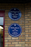 West Ham United 2 Crystal Palace 2, 02/04/2016. Boleyn Ground, Premier League. Commemorative blue plaques to Bobby Moore and Ron Greenwood at the Boleyn Ground after West Ham United hosted Crystal Palace in a Barclays Premier League match. The Boleyn Ground at Upton Park was the club's home ground from 1904 until the end of the 2015-16 season when they moved into the Olympic Stadium, built for the 2012 London games, at nearby Stratford. The match ended in a 2-2 draw, watched by a near-capacity crowd of 34,857. Photo by Colin McPherson.