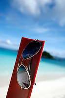 September 2008: Sunglasses at Trunk Bay on St. John US Virgin Islands beach scenes.  Stock photos available.