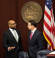 TALLAHASSEE, FLA. 5/3/13-SESSIONEND050313CH-Sen. Oscar Braynon II, D-Miami, left, talks with House Speaker Will Weatherford, R-Wesley Chapel, during the final day of the legislative session May 3, 2013 at the Capitol in Tallahassee. Braynon is leading the effort in the Senate to effort to get hotel bed tax dollars for improvements to the Miami Dolphin's stadium...COLIN HACKLEY PHOTO