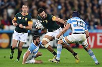 Damian de Allende of South Africa takes on the Argentina defence. Rugby World Cup Bronze Final between South Africa and Argentina on October 30, 2015 at The Stadium, Queen Elizabeth Olympic Park in London, England. Photo by: Patrick Khachfe / Onside Images