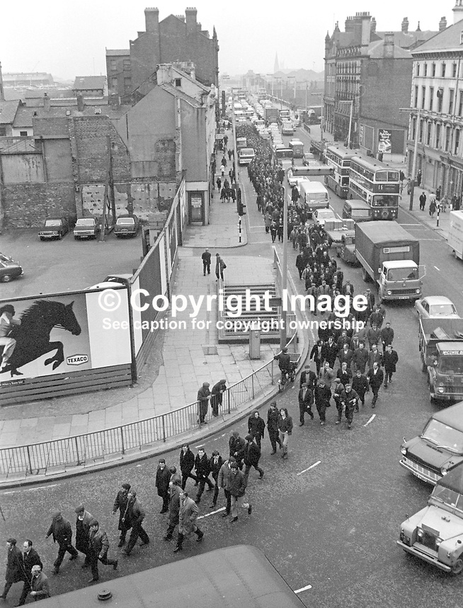 Shipyard workers march to Ulster Unionist Party headquarters in Glengall Street, Belfast, N Ireland, UK, to protest at the government's law and order policy following the Provisional IRA murder of three Scottish soldiers, two of whom were brothers, Private John McCaig, 17 years, and Joseph McCaig, 18 years, and their friend, Dougald McCaughey, 23 years. They were all members of the Royal Highland Fusiliers. 197103120164<br />