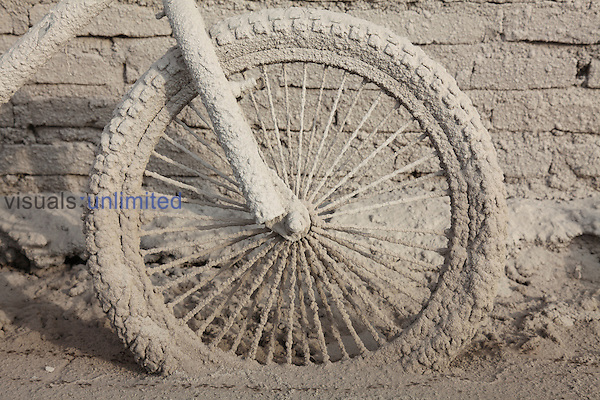 Bicycle wheel coated in volcanic ash from 2014 eruption of Sinabung Volcano, Sumatra, Indonesia