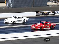 Feb 14, 2016; Pomona, CA, USA; NHRA pro stock driver Joey Grose (left) races alongside Drew Skillman during the Winternationals at Auto Club Raceway at Pomona. Mandatory Credit: Mark J. Rebilas-USA TODAY Sports
